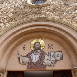 Above the main door of the church at St Maxime
