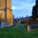 The churchyard is well lit in the evening