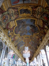 The magificent vaulted ceiling in the Hall of Mirrors - covered with paintings by Le Brun.