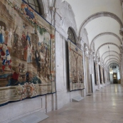 Tapestries line this portico