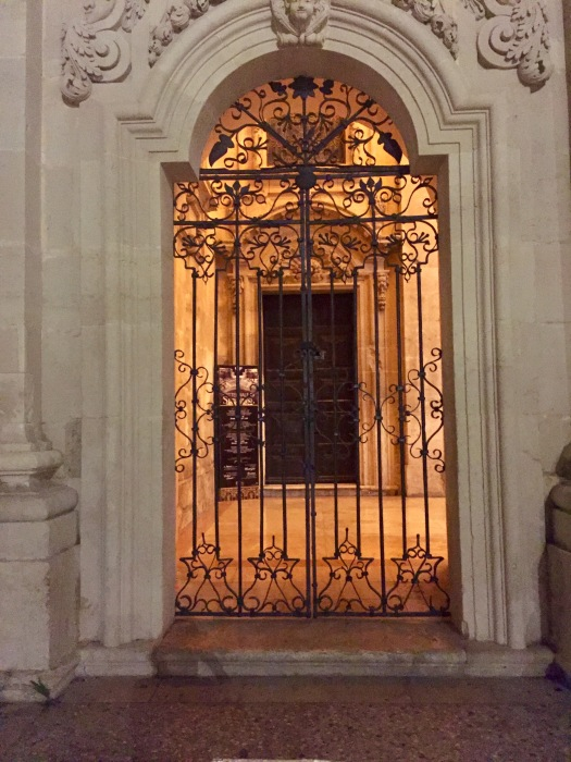 The tempting closed gate barring access to the Duomo at night