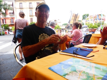 Phil sitting on the roadside cafe beside the Piazza Torquato Tasso