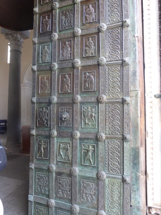 The heavy bronze doors leading into the church - reminiscent of the Gates of Paradise in the Bapistery in Florence