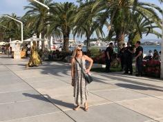 Golden street performer behind the women in the long dress